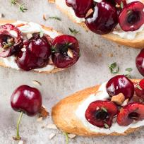 Cherry Goat Cheese Crostini with Thyme and Almonds Recipe