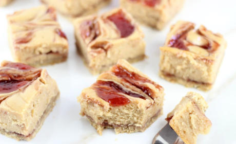 Peanut Butter & Jelly Swirl Cheesecake Bars