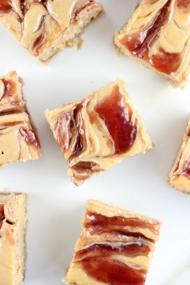 Peanut Butter & Jelly Swirl Cheesecake Bars - Food Fanatic