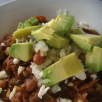 Chili Con Carne with avocado, cotija cheese and minced onion